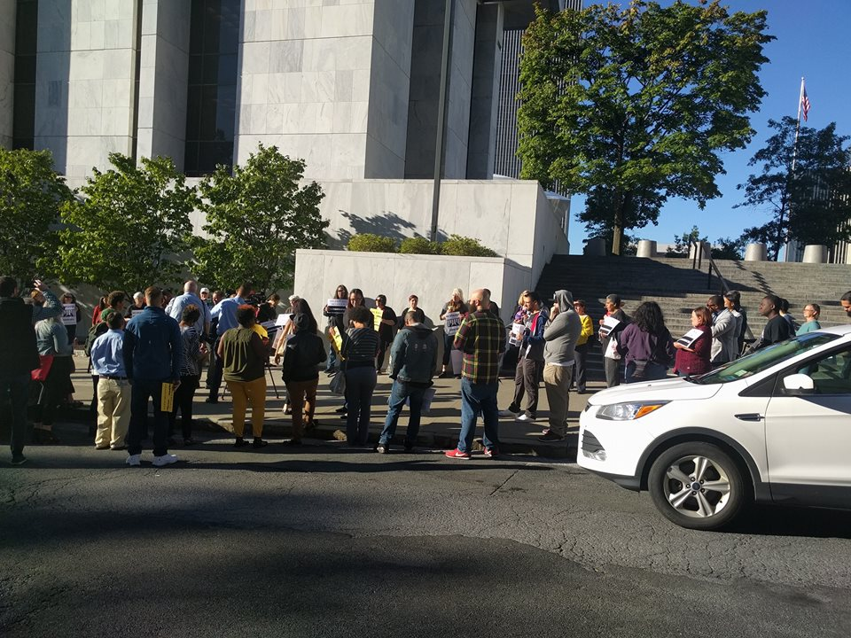 Supporters gathered outside the Justice building before the hearing.